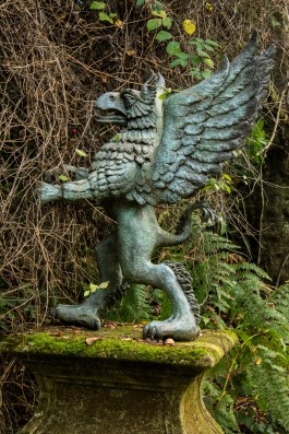 John Ramera, Griffin, Bronze on Carved Limestone at The Sculpture Park