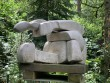 Abstract stone sculpture in three interlocking pieces by British School mid 20th century at The Sculpture Park