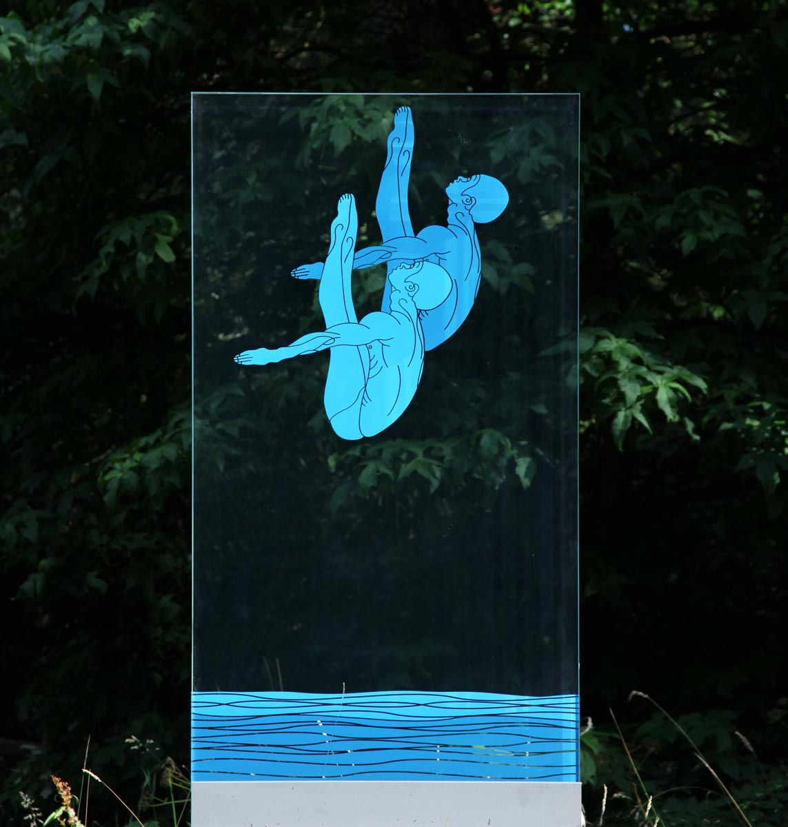 Divers by Esbe is a clear toughened glass panel with blue figures depicting two divers transferred onto the surface, one of many glass sculptures for sale at The Sculpture Park