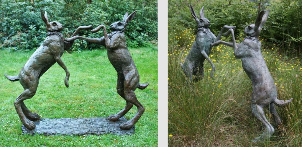 Boxing Hares by Lucy Kinsella titled Moondance, cast in bronze set in the valley at The Sculpture Park in Churt, Surrey